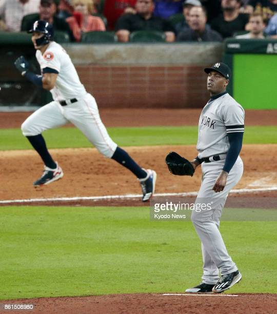New York Yankees closer Aroldis Chapman allows Houston Astros' Carlos Correa a walkoff double in the ninth inning of an American League Championship...
