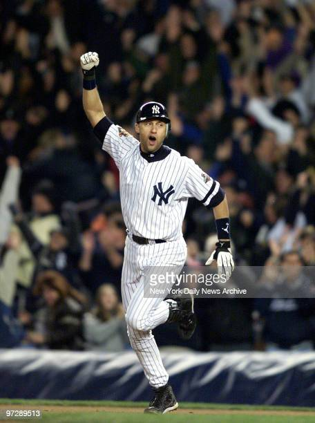 New York Yankees' Derek Jeter celebrates after hitting game winning homerun in 10th inning against Arizona Diamondbacks in 2001 World Series