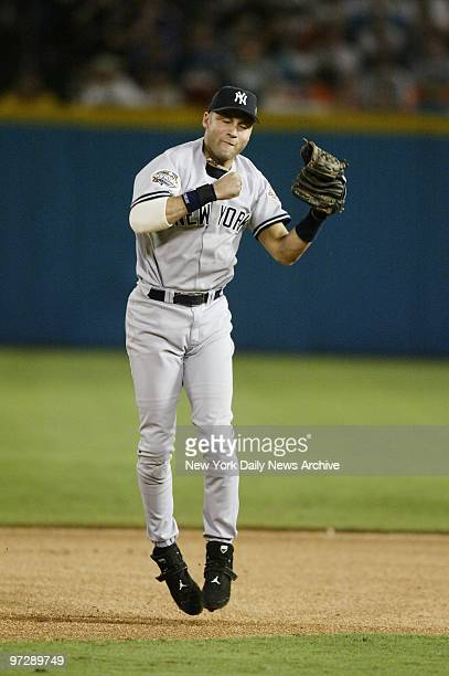 New York Yankees' Derek Jeter exults after tagging out Florida Marlins' Juan Pierre at second during a steal attempt in the fifth inning of Game 3 of...
