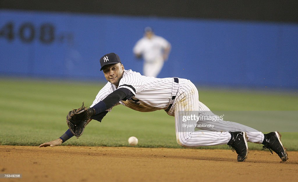 New York Yankees Derek Jeter fielding in a regular season game against the Boston Red Sox played at Yankee Stadium in Bronx NY Red Sox defeated the...