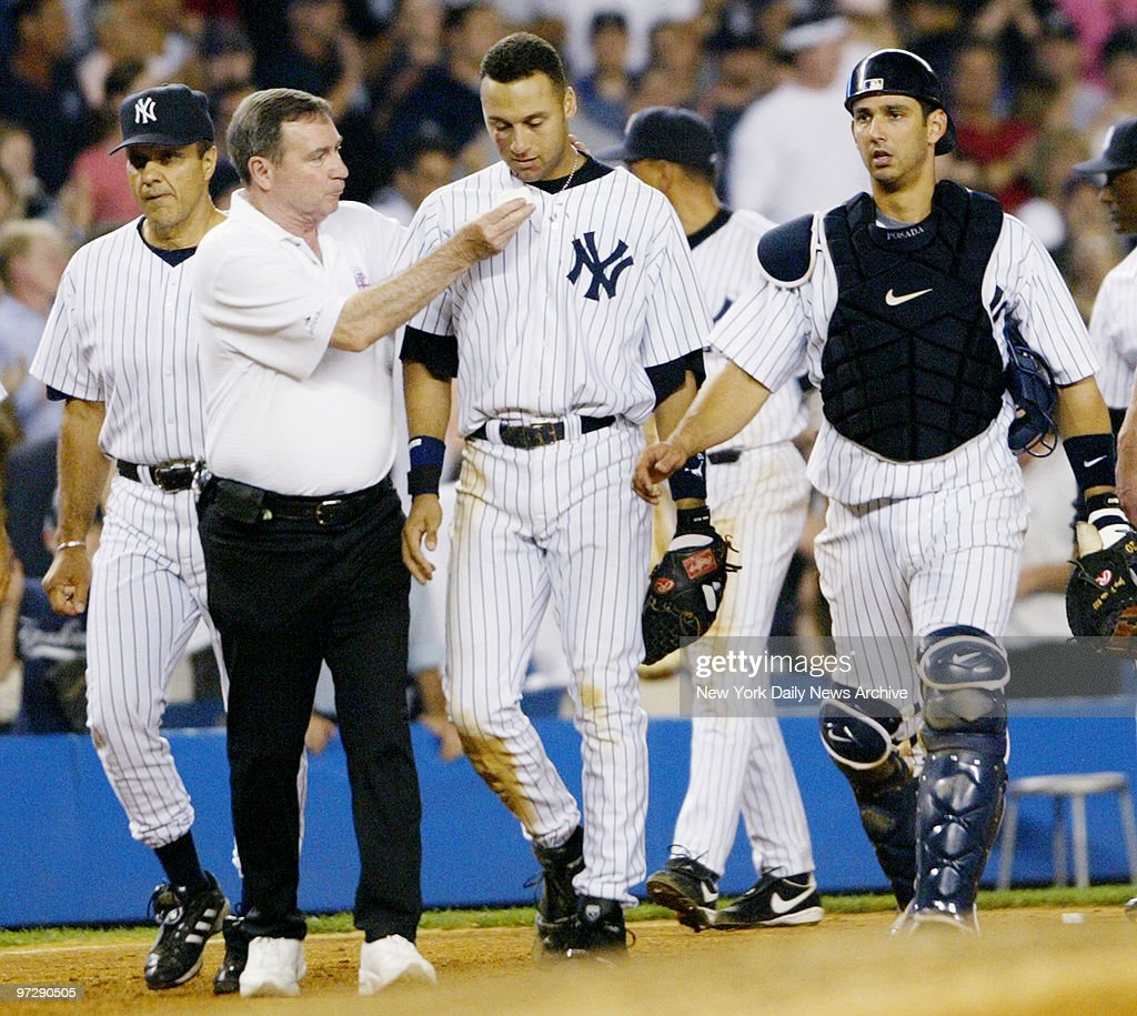 New York Yankees' Derek Jeter leaves game after diving into Stadium stands to make runsaving catch by Boston's Trot Nixon in 12th during game against...