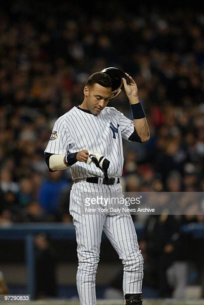 New York Yankees' Derek Jeter reacts after he struck out swinging in the fifth inning of Game 6 of the World Series against the Florida Marlins at...