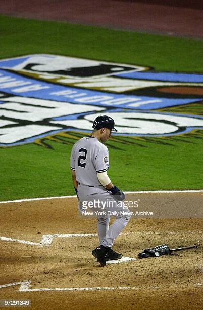 New York Yankees' Derek Jeter steps on the plate as he scores on a basesloaded walk in the fourth inning of Game 3 of the World Series against the...