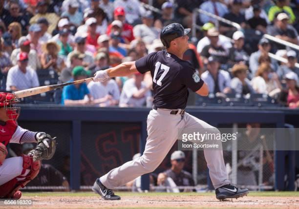 New York Yankees Designated Hitter Matt Holliday hits a home run batting in New York Yankees Infielder Greg Bird during an MLB spring training game...