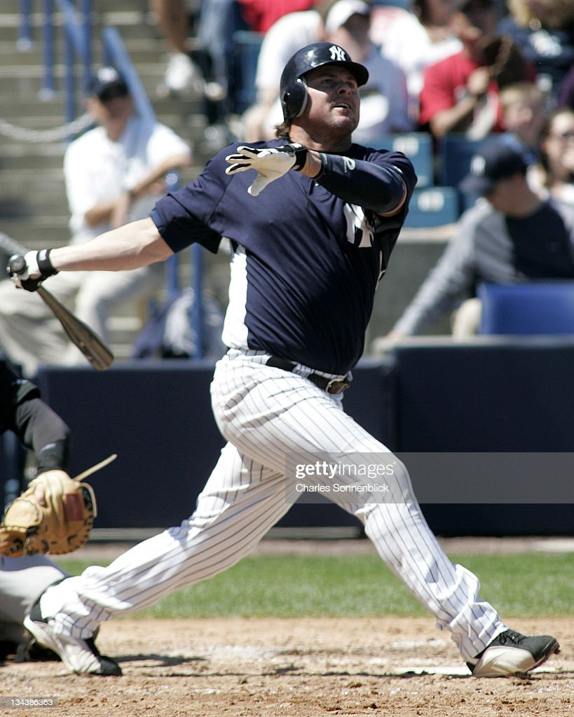 New York Yankees DH Jason Giambi drives the ball deep the Pittsburgh Pirates during a spring training game on March 18 2007 at Legends Field in Tampa...