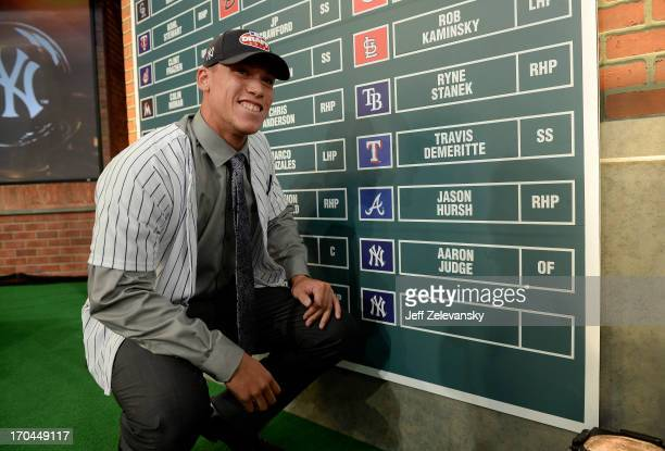 New York Yankees draftee Aaron Judge poses near the draft board at the 2013 MLB FirstYear Player Draft at the MLB Network on June 6 2013 in Secaucus...