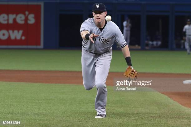 TORONTO ON AUGUST 10 New York Yankees first baseman Garrett Cooper tosses the ball towards first base as the Toronto Blue Jays shutout the New York...