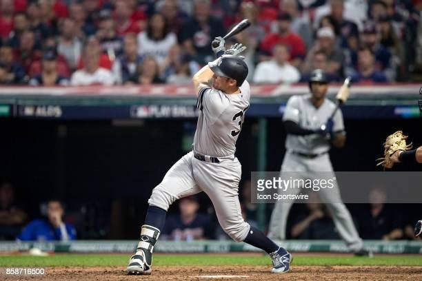 New York Yankees first baseman Greg Bird belts a 2run home run during the ffith inning of the 2017 American League Divisional Series Game 2 between...
