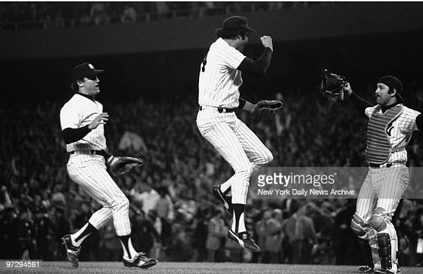 New York Yankees' Graig Nettles and catcher Thurman Munson converge on gamewinning pitcher MikeTorrez in Game Six of the 1977 World Series against...
