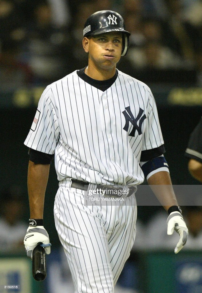 New York Yankees infielder <a gi-track='captionPersonalityLinkClicked' href=/galleries/search?phrase=Alex+Rodriguez+-+Baseball+Player&family=editorial&specificpeople=167080 ng-click='$event.stopPropagation()'>Alex Rodriguez</a> reacts during an at-bat in the third inning of their exhibition game against the Hanshin Tigers Japanese professional baseball team at the Tokyo Dome stadium in Tokyo, 29 March 2004. The Yankees are in Japan for a series of exhibition games and to open the Major League Baseball season against Tampa Bay 30 March in Tokyo. AFP PHOTO/Toru YAMANAKA