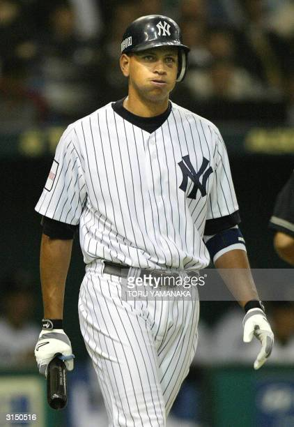 New York Yankees infielder Alex Rodriguez reacts during an atbat in the third inning of their exhibition game against the Hanshin Tigers Japanese...