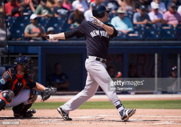 New York Yankees Infielder Chase Headley bats and hits a double batting in New York Yankees Outfielder Brett Gardner and New York Yankees Outfielder...