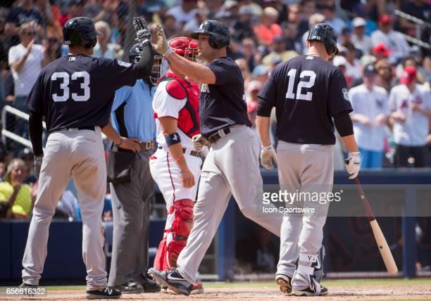New York Yankees Infielder Greg Bird fist bumps New York Yankees Designated Hitter Matt Holliday as he celebrates hitting a home run and batting in...