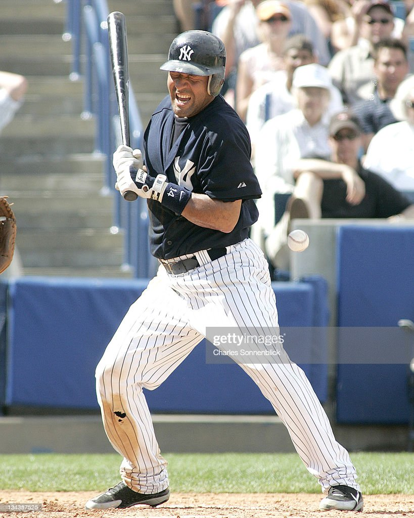 New York Yankees infielder Miguel Cairo gets beaned by a pitch in a spring training game against the Atlanta Braves Saturday March 11 2006 at Legends...