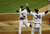 New York Yankees' Karim Garcia and and Nick Johnson celebrate their runs in the fourth inning of Game 6 of the American League Championship Series...