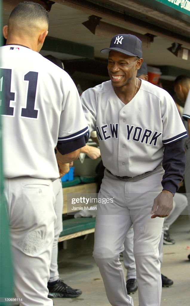 New York Yankees' Kenny Lofton (R) and Miguel Cairo (#41)share a light moment prior to their game against the Cleveland Indians Monday August 23, 2004 in Jacobs Field in Cleveland, Ohio. The Yankees won the game 6-4.