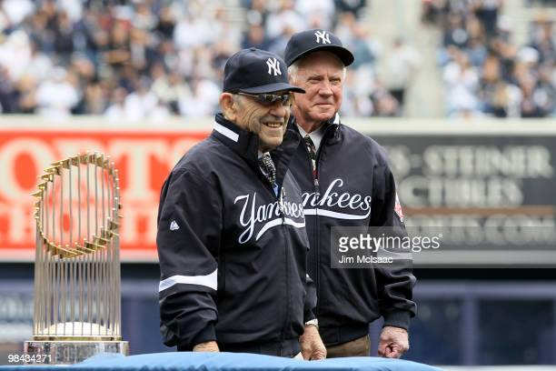 New York Yankee's legends and Baseball Hall of Famers Yogi Berra and Whitey Ford stand on the field for the presentation of the New York Yankees with...