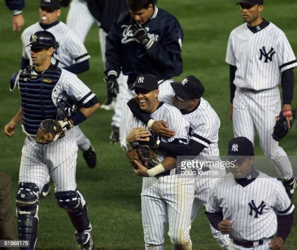 New York Yankees Luis Sojo gets a hug from Jose Vizcaino at the end of the Yankees game against the Oakland Athletics during the American League...