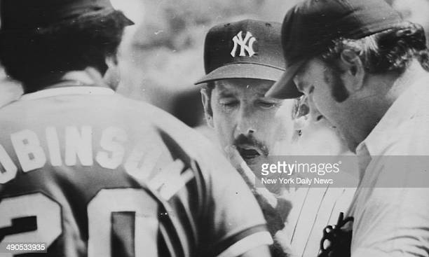 New York Yankees manager Billy Martin arguing with umpire and player from other team