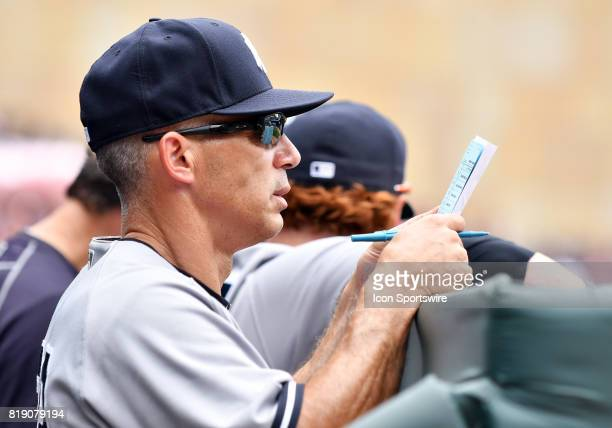 New York Yankees Manager Jo Girardi checks his lineup card during a MLB game between the Minnesota Twins and New York Yankees on July 19 2017 at...