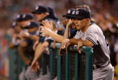 New York Yankees manager Joe Girardi looks on during the game against the Los Angeles Angels of Anaheim at Angel Stadium on September 22 2009 in...