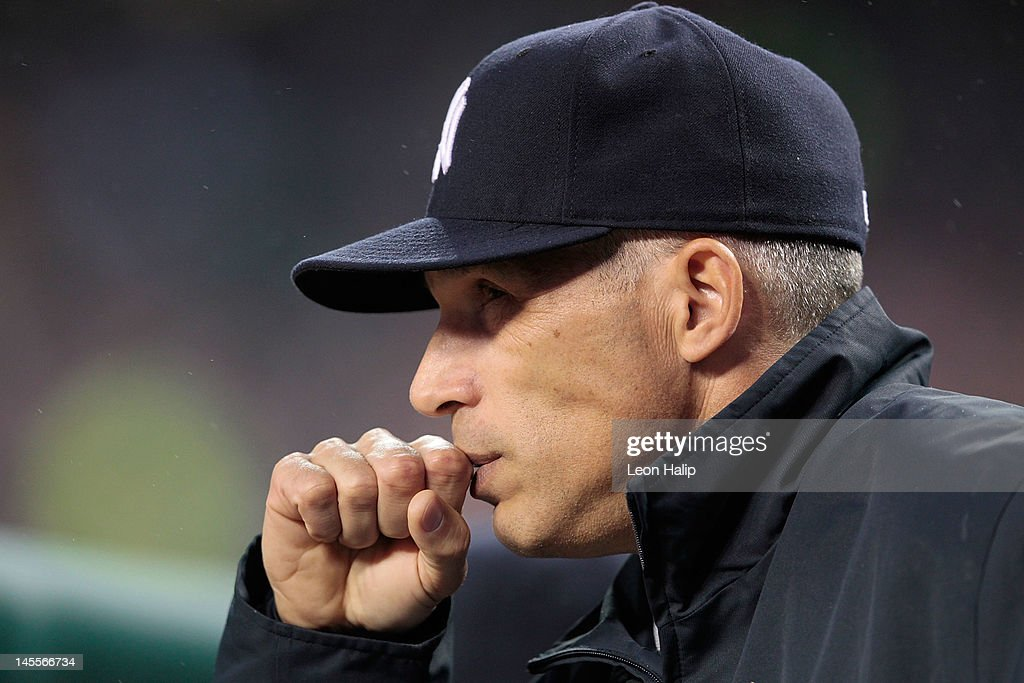 New York Yankees manager <a gi-track='captionPersonalityLinkClicked' href=/galleries/search?phrase=Joe+Girardi&family=editorial&specificpeople=208659 ng-click='$event.stopPropagation()'>Joe Girardi</a> #28 watches the action during the game against the Detroit Tigers at Comerica Park on June 1, 2012 in Detroit, Michigan. The Yankees defeated the Tigesr 9-4.