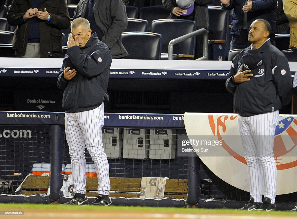 New York Yankees manager Joe Girardi wipes tears from his eyes after a moment of silence for his father who died on Saturday prior to Game 4 of the American League Division Series agains the Baltimore Orioles at Yankees Stadium in New York on Thursday, October 11, 2012.