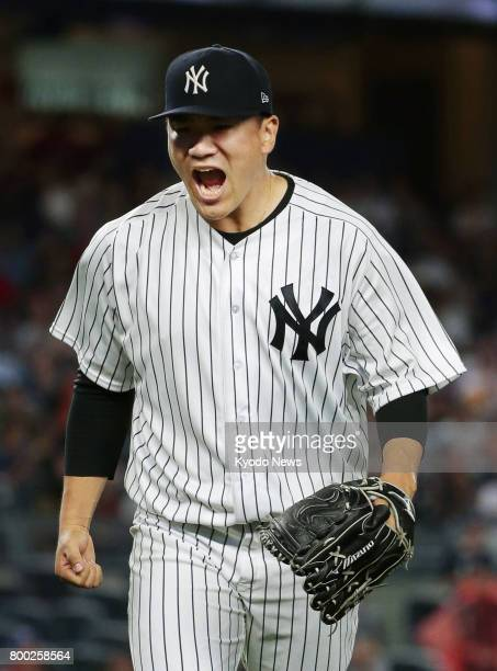 New York Yankees' Masahiro Tanaka reacts after pitching eight scoreless innings in a game against the Texas Rangers at Yankee Stadium in New York on...