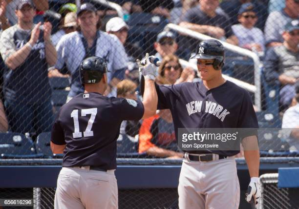 New York Yankees Outfielder Aaron Judge fist bumps New York Yankees Designated Hitter Matt Holliday as he celebrates hitting a home run and batting...