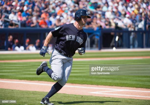 New York Yankees Outfielder Brett Gardner runs to first base after batting during an MLB spring training game between the New York Yankees and the...