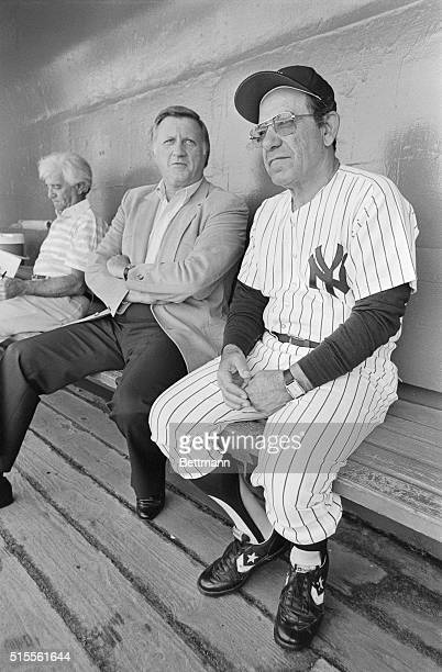 New York Yankees owner George Steinbrenner and Manager Yogi Berra laugh it up in the dugout after a comment was made about the fat stomach of a...