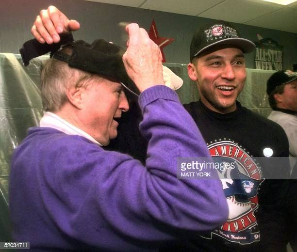New York Yankees owner George Steinbrenner puts on an American League Championship hat with Derek Jeter in their locker room after his team's 61...