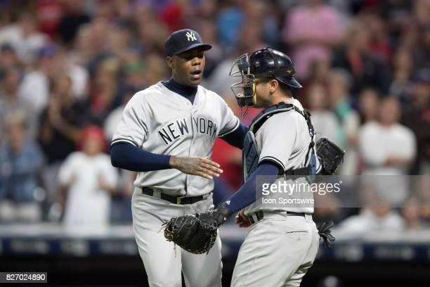 New York Yankees pitcher Aroldis Chapman and New York Yankees catcher Austin Romine celebrate following the Major League Baseball game between the...