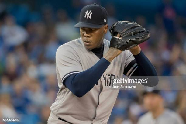 New York Yankees Pitcher Aroldis Chapman pitches late in the game during the regular season MLB game between the New York Yankees and the Toronto...