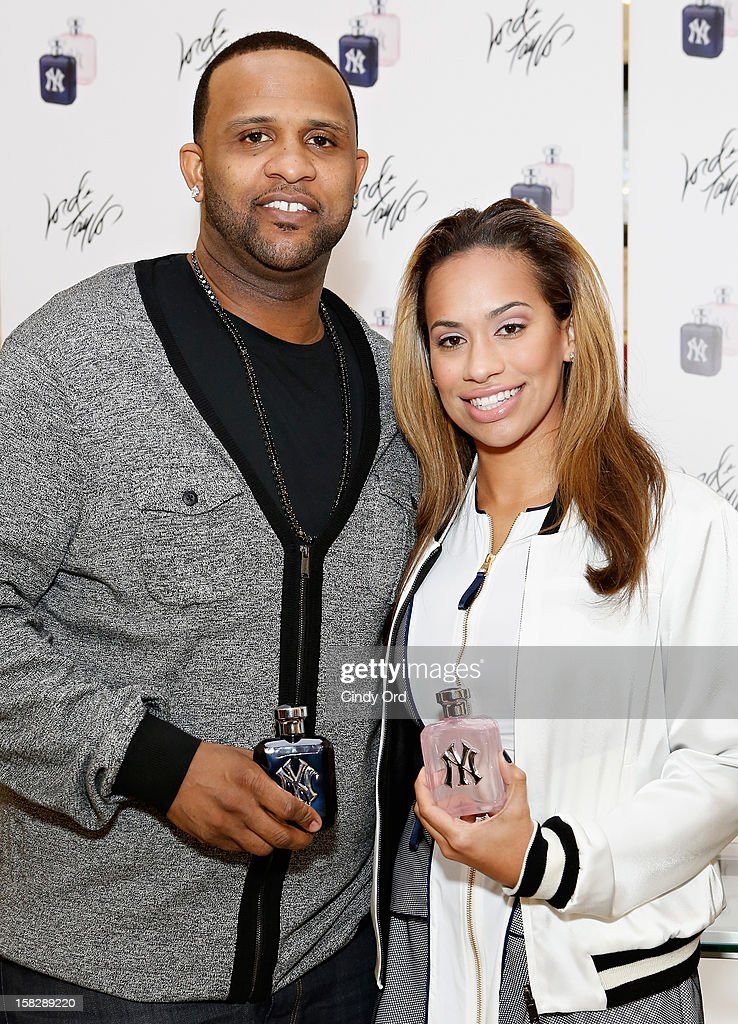 New York Yankees pitcher CC Sabathia and his wife Amber Sabathia attend the CC And Amber Sabathia 'New York Yankees' Fragrance Event at Lord And Taylor on December 12, 2012 in New York City.