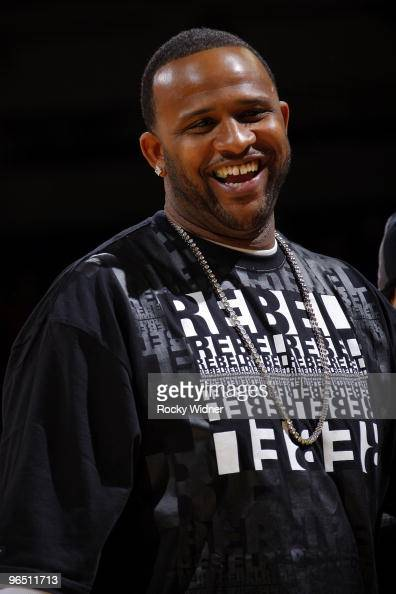 New York Yankees pitcher CC Sabathia smiles as he attends the game between the Charlotte Bobcats and the Golden State Warriors at Oracle Arena on...