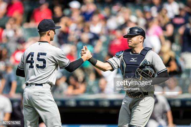 New York Yankees pitcher Chasen Shreve and New York Yankees catcher Austin Romine celebrate following the Major League Baseball game between the New...