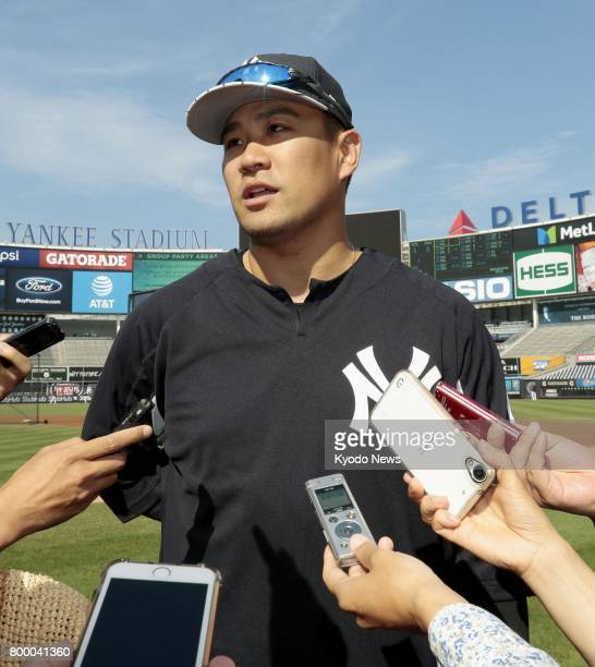 New York Yankees pitcher Masahiro Tanaka speaks to reporters at Yankee Stadium on June 22 a day before his start against the Texas Rangers Japanese...