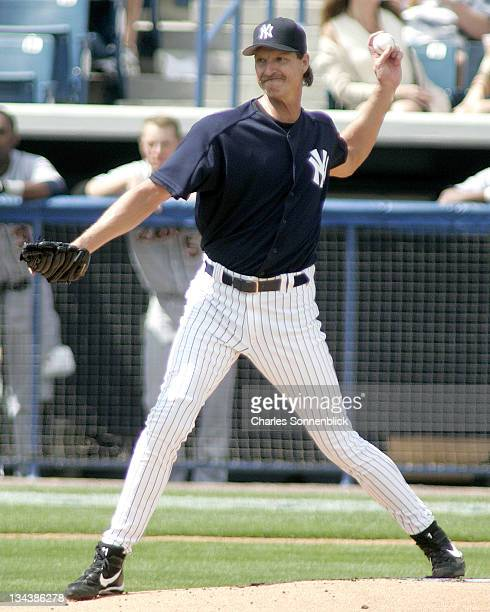 New York Yankees pitcher Randy Johnson throws to first in a pickoff attempt in a spring training game against the Detroit Tigers on Thursday March 9...