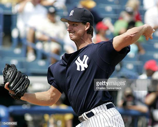 New York Yankees pitcher Randy Johnson warms up in a spring training game against the St Louis Cardinals Tuesday March 14 2006 at Legends Field in...