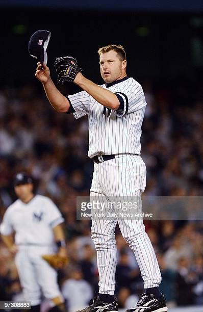 New York Yankees' pitcher Roger Clemens doffs his hat to the cheering fans after moving into third place on the alltime strikeout list in the fourth...