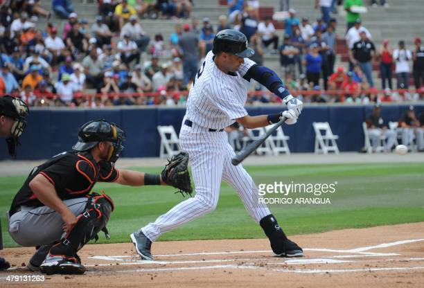New York Yankees player Derek Jeter hits during an exhibition game in Panama City on March 16 2014 Panama will get a taste of Major League Baseball...