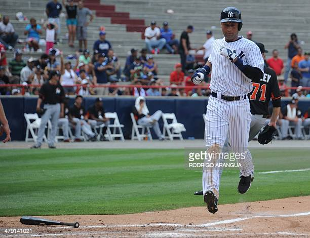 New York Yankees player Derek Jeter scores during an exhibition game in Panama City on March 16 2014 Panama will get a taste of Major League Baseball...