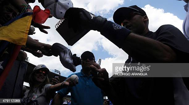 New York Yankees player Derek Jeter signs autographs before an exhibition game in Panama City on March 16 2014 Panama will get a taste of Major...