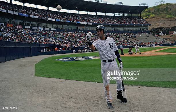 New York Yankees' player Derek Jeter waves to fans during a baseball exhibition game in Panama City on March 16 2014 The New York Yankees play the...