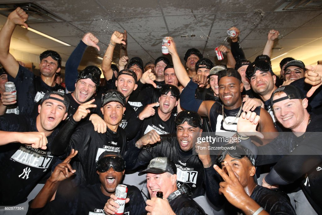 New York Yankees players celebrate their playoff-clinching victory in their clubhouse during MLB game action against the Toronto Blue Jays at Rogers Centre on September 23, 2017 in Toronto, Canada.
