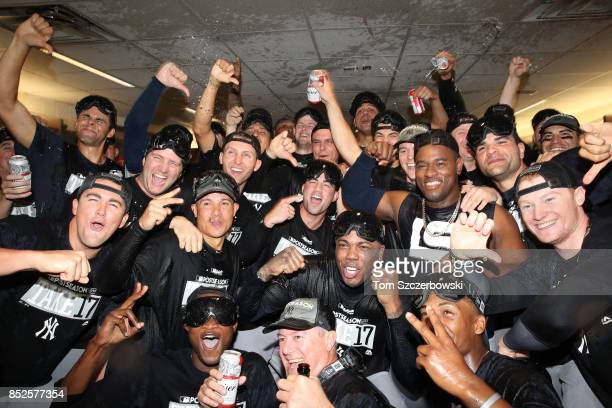 New York Yankees players celebrate their playoffclinching victory in their clubhouse during MLB game action against the Toronto Blue Jays at Rogers...