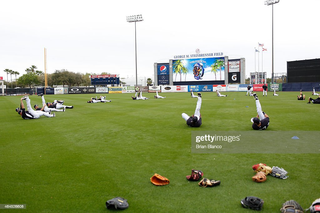 New York Yankees players stretch as they participate in a spring training workout on February 26 2015 at George M Steinbrenner Field in Tampa Florida