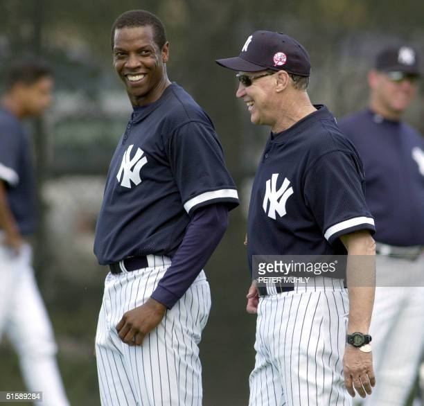 New York Yankees playher Dwight Gooden stands with pitching coach Mel Stottlemyre 16 February 2001 during a morning workout The New York Yankees...