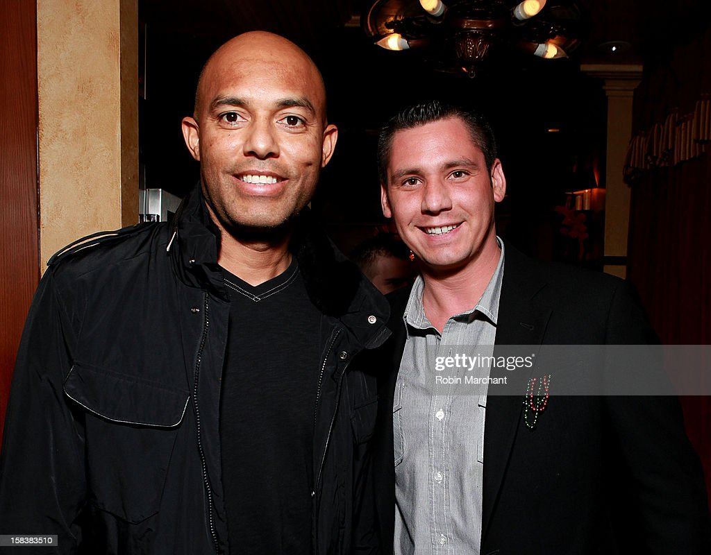 New York Yankees relief pitcher <a gi-track='captionPersonalityLinkClicked' href=/galleries/search?phrase=Mariano+Rivera&family=editorial&specificpeople=201607 ng-click='$event.stopPropagation()'>Mariano Rivera</a> (L) and Alex Carr attend Elvis Duran Morning Show Holiday Party at Carmine's on December 14, 2012 in New York City.